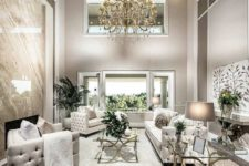 09 a luxe space in the shades of grey, cream and gold for a fantastic ambience