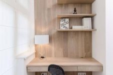 09 a minimal home office corner is done in white and natural wood, the furniture is clean and sleek
