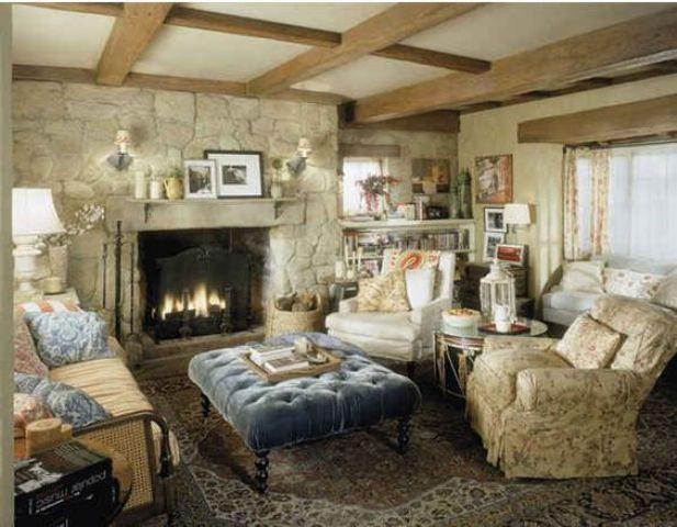 a neutral vintage space centered around a fireplace in a stone wall