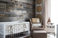 09 a rustic themed nursery with a reclaimed wood wall, burlap and wicker touches