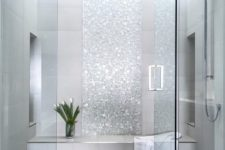 09 a shower and steam room done with grey tiles and shiny silver accents looks very glam and cute