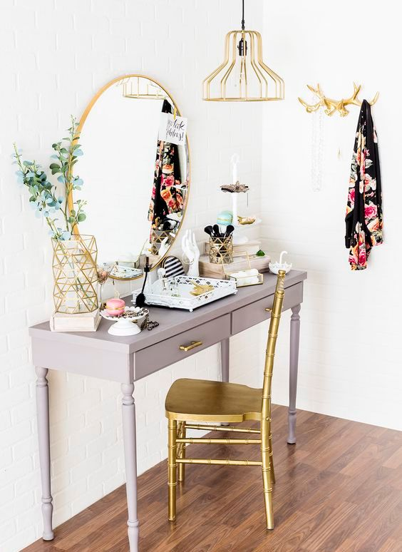 vintage grey desk with drawers and gold accents for a outique-style look