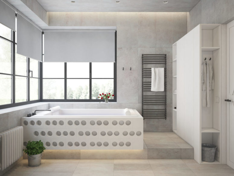 The bathtub is also interesting, and the bathroom tiles remind of concrete shades