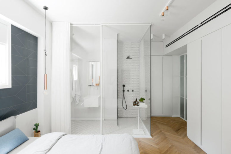 The master bedroom features a shower space integrated right into the room