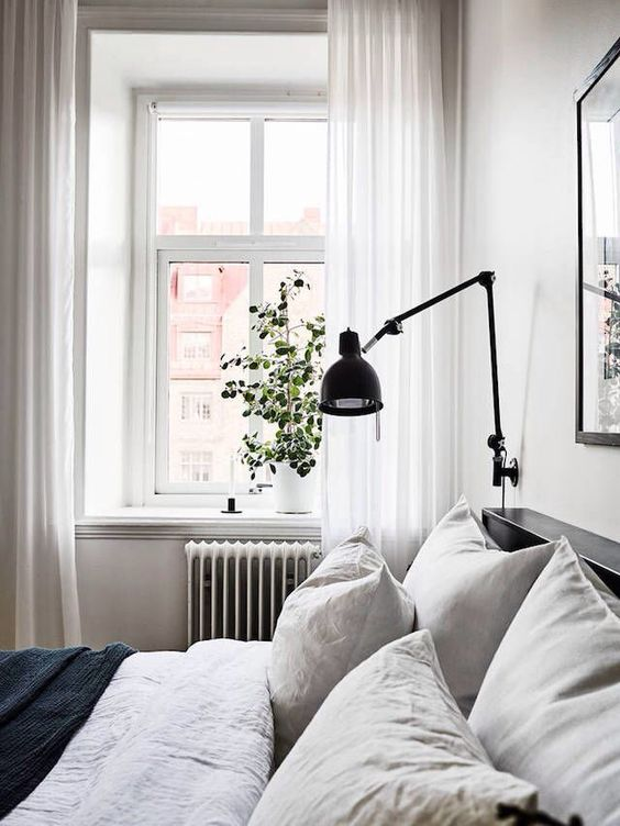 a black sconce is great for a Scandinavian or modern space with a simple color palette