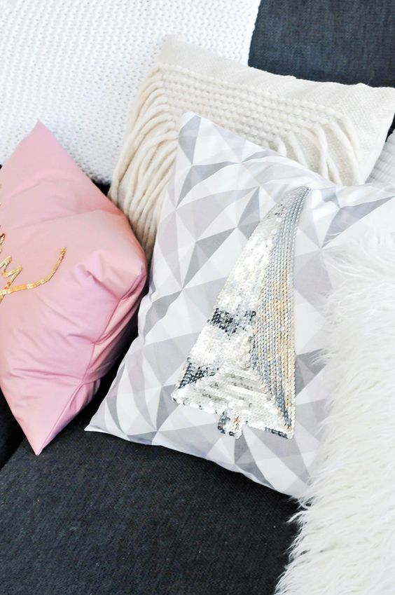 a geometric pillow with a silver sequin Christmas tree can be easily DIYed