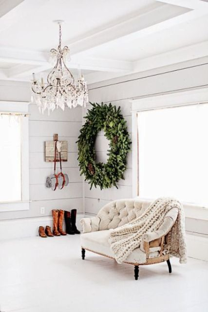 a large rustic evergreen wreath with large pinecones will make a statement in any space
