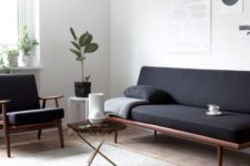 10 a minimalist interior with a Scandinavian feel, wood framed furniture and a jute rug
