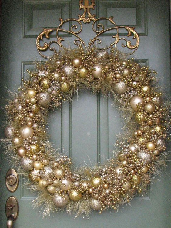 a mixed metals Christmas wreath in silver, gold and champagne colors
