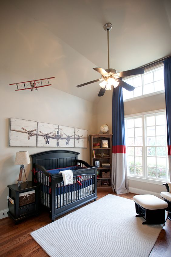 an aviation-themed nursery for a boy, navy, red and white for the color scheme