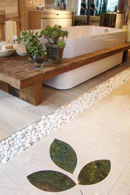 pebbles in between the floor tiles, a wooden bench and potted succulents will create a relaxing ambience