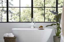 11 The master bathroom features a free-standing bathtub and a glazed wall for cool views