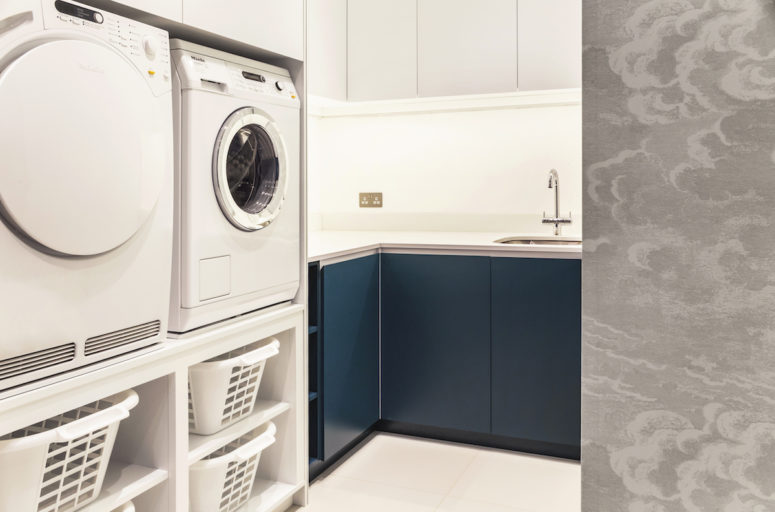 The new utility room is situated on the second floor and is very space-efficient, featuring lots of storage in a small space