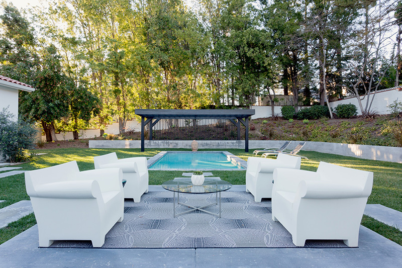 There's a terrace, a swimming pool and some comfy chairs