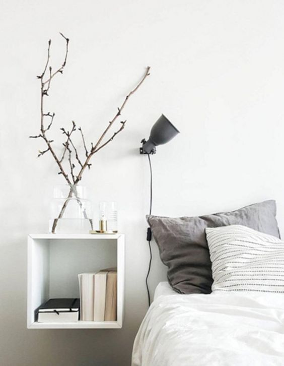 a comfy matte grey wall sconce that can be rotated in different ways for comfy using