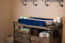 11 a dresser of reclaimed wood features open storage and can serve as a changing table