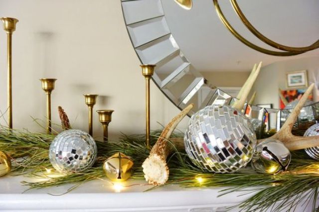 a glam mantel with a large mirror, shiny metal ornaments and LEDs