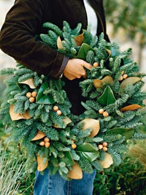 a gorgeous wreath of evergreens, acorns and magnolia leaves for a unique holiday decoration