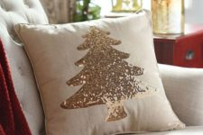 11 a neutral pillow with a champagne sequin Christmas tree looks very holiday-like