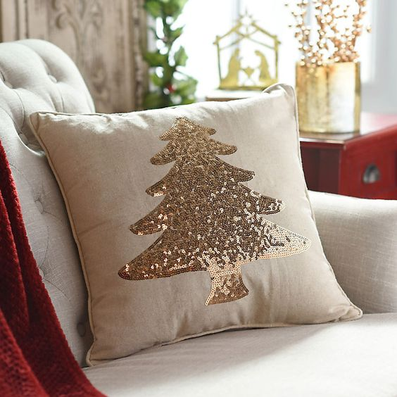 a neutral pillow with a champagne sequin Christmas tree looks very holiday-like