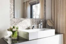 11 a shiny metal tile wall to highlight the sink and vanity and make them more glam