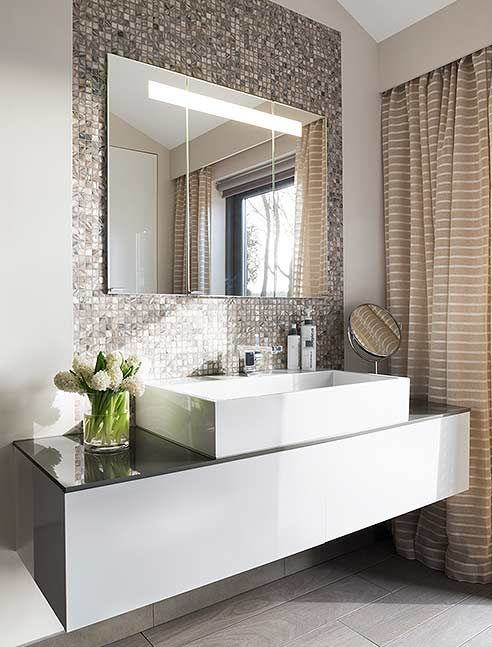 a shiny metal tile wall to highlight the sink and vanity and make them more glam