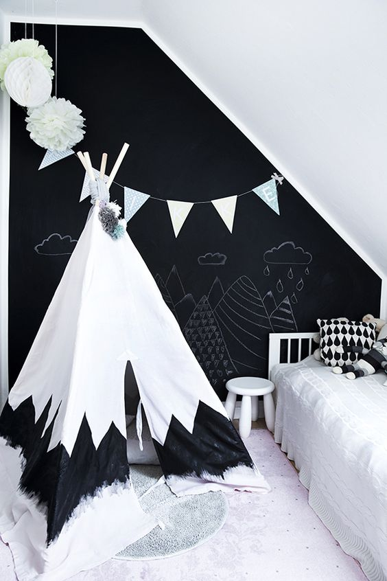 a clean Scandinavian space with a chalkboard accent wall is great for cheering the space up