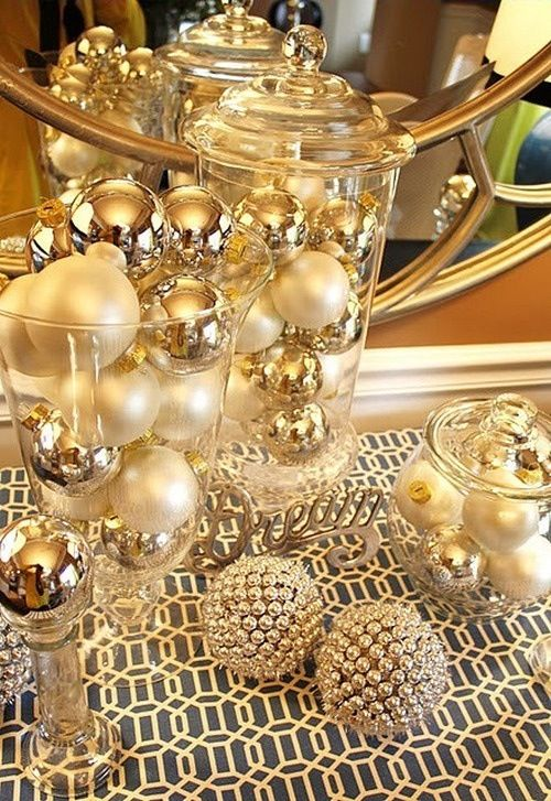 a festive gold and pearly ornament display in jars
