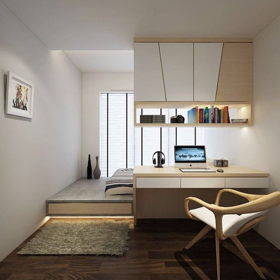 a minimalist desk with a suspended storage unit over it works as a space divider in this bedroom