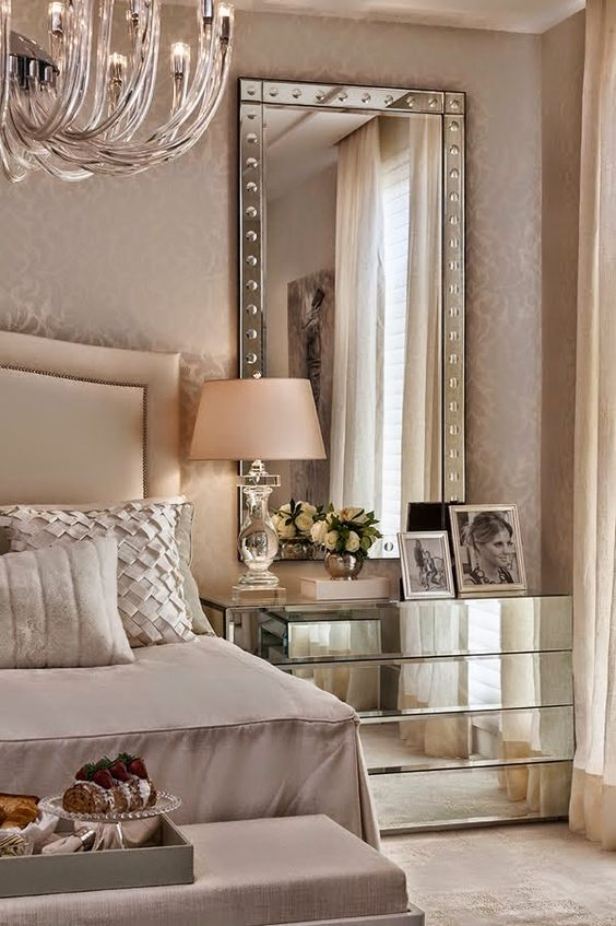 mirrors and mirrored nightstands are great to add a shiny touch to your space