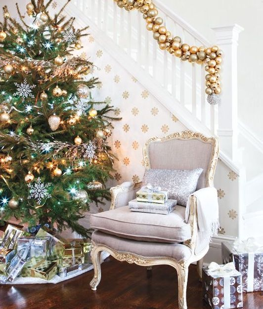 a cool gold ornament garland for decorating the staircase