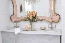 13 a large mirror in a unique vitnage frame with a metal touch brings chic and glam