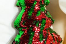 13 a reverse sequin red and emerald sequin Christmas tree pillow is sure to catch an eye