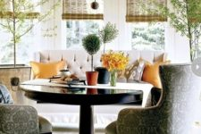 13 a stylish breakfast or dining zone with upholstered furniture and a round pedestal table with a traditional feel