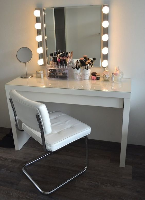 a usual modern mirror with much light on each side
