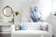 13 brass touches and a large crystal chandelier will give your space a glam feel