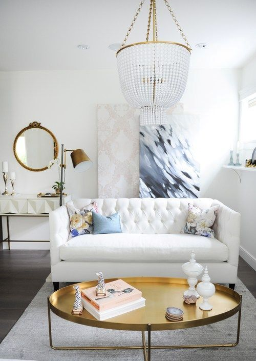 brass touches and a large crystal chandelier will give your space a glam feel
