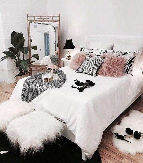 faux fur pillows, stools and a rug make the space adorably girlish