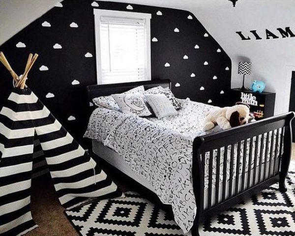 a black statement wall with a cloud print makes the space more eye-catching