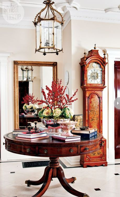 a gorgeous vintage redwood table in the entryway is a fantastic idea for a luxurious interior
