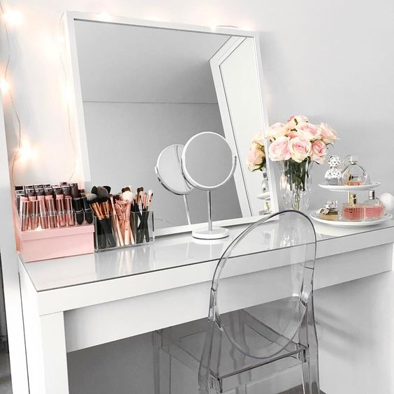 a modern square mirror put on the vanity and an additional small one