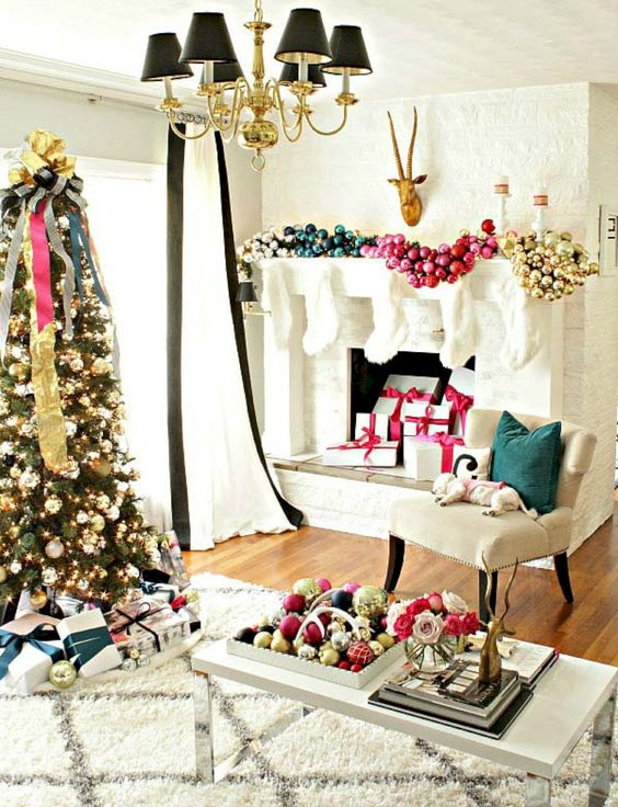 an oversized glam fireplace garland made of ornaments of different colors and a matching display