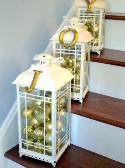 white lanterns filled with gold and gold glitter ornaments are great for marking the steps