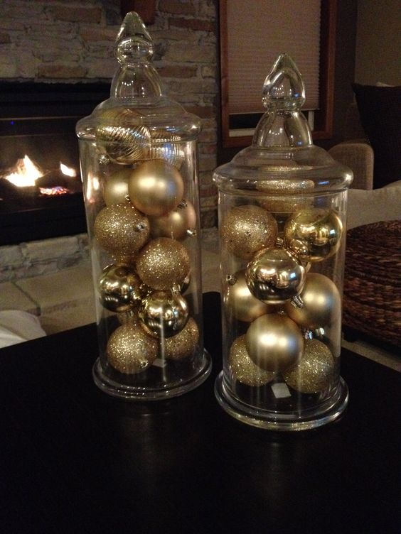 display some gold and gold glitter ornaments in jars to get chic Christmas decor