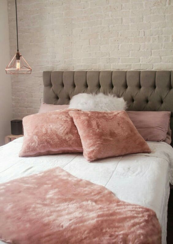 pink faux fur pillows and a blanket are sure to make your sleeping amazing