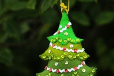 16 a felt Christmas tree ornament in different shades of green and with sequins can be DIYed