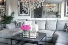 16 mirrors, mirror frames and a crystal chandelier spruce up the grey space