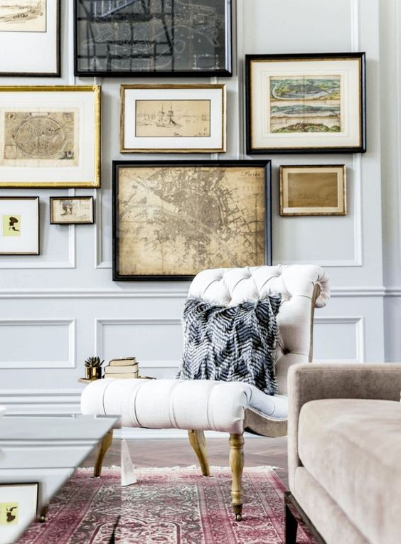 the panel molding makes these very light grey walls really stand out and look chic