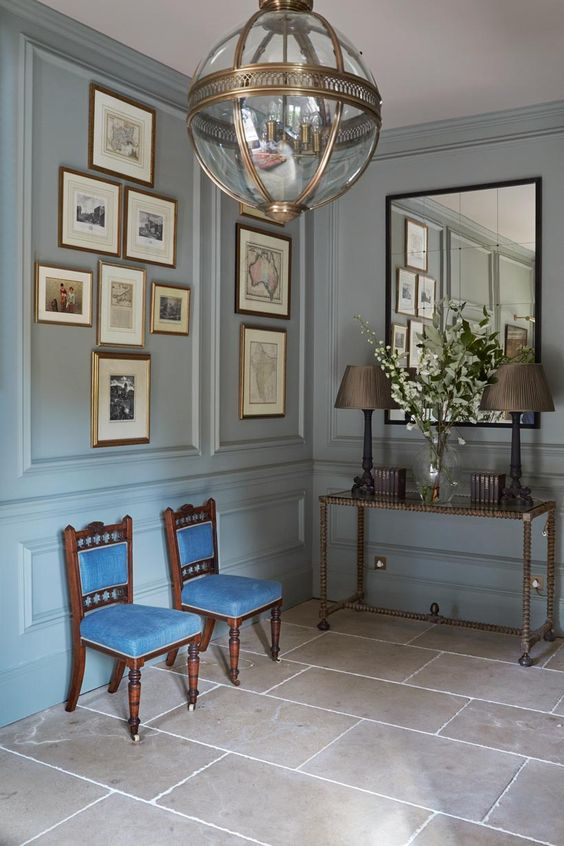 choose a soft pastel shade and go for panels on the wall to make your entryway refined