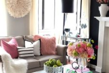 17 faux fur, crystals and a mirrored coffee table for a glam feel in the space